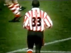 Ali Dia with 33 To the back.
