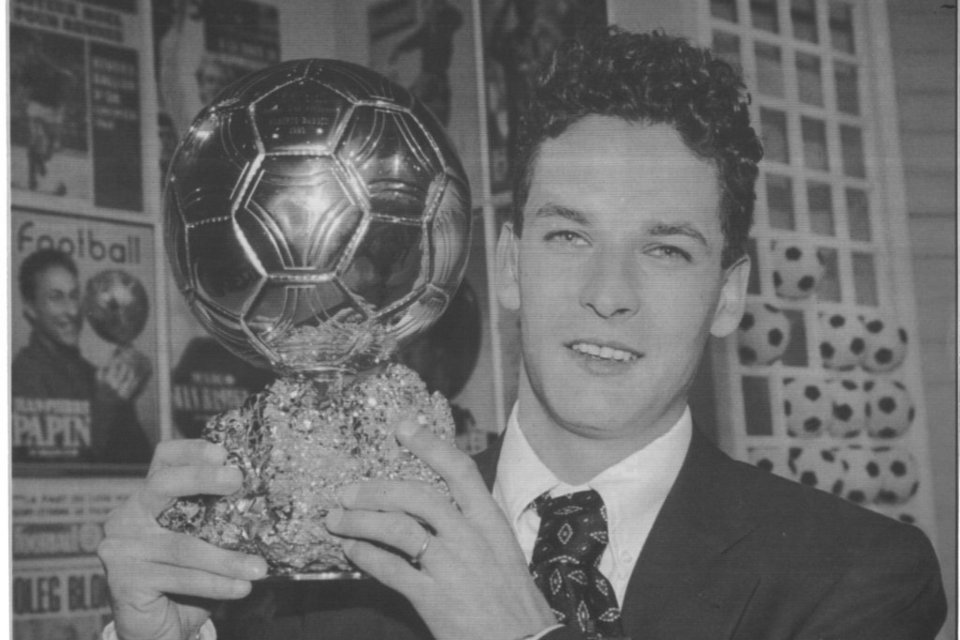 Roberto Baggio poses proudly with his Ballon d'Or