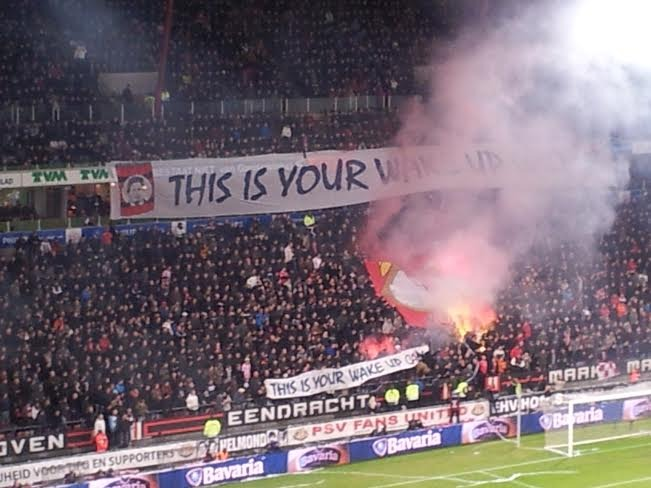 "The crowd encouraged PSV with a banner reading: ""despierta ya""."