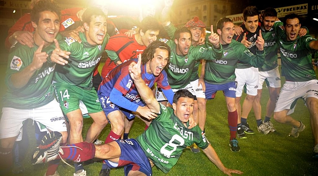 Eibar players celebrate their promotion to.