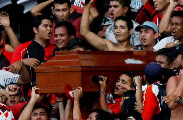 A group of fans came to put a coffin in South America on a football field.