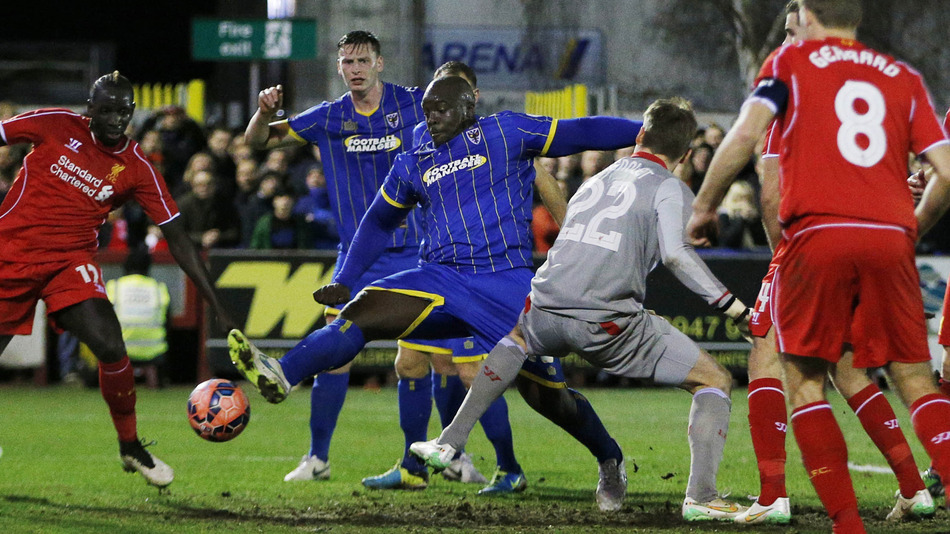 Akinfenwa Marco al Liverpool en la Copa inglesa.