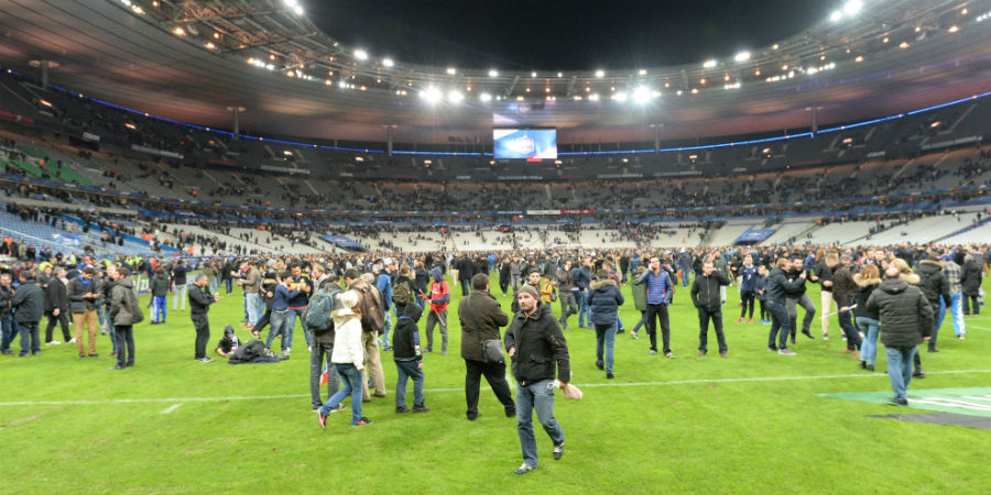 People had to wait in the grass waiting to be evacuated. The terrorist came to football madness.