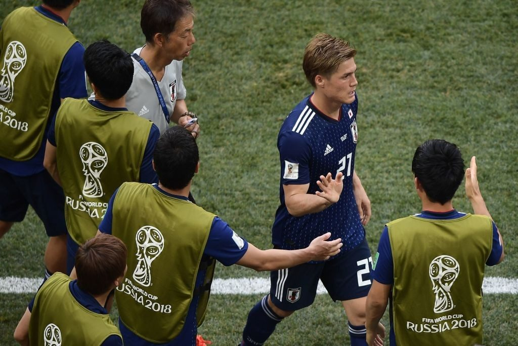 Japan qualifies for second round by cards
